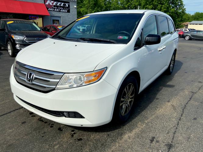 2012 White Honda Odyssey EX (5FNRL5H43CB) with an 3.5L V6 SOHC 24V engine, 5-Speed Automatic transmission, located at 547 E. Main St., Orwell, OH, 44076, (440) 437-5893, 41.535435, -80.847855 - Photo #0