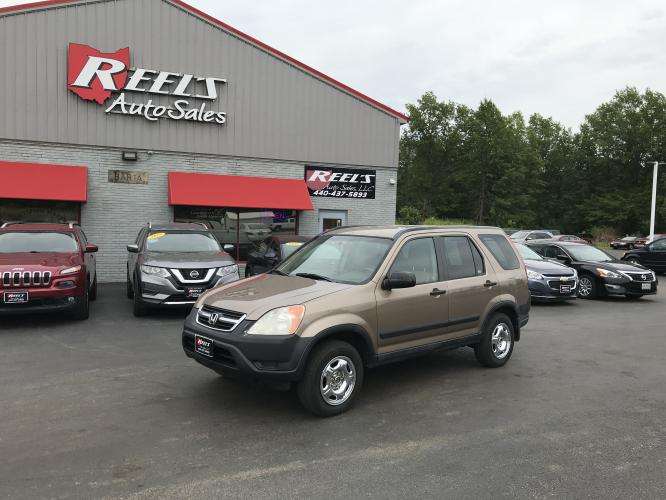 2004 Gold /Tan Honda CR-V LX 4WD AT (SHSRD78474U) with an 2.4L L4 DOHC 16V engine, 4-Speed Automatic Overdrive transmission, located at 11115 Chardon Rd. , Chardon, OH, 44024, (440) 214-9705, 41.580246, -81.241943 - Photo #0