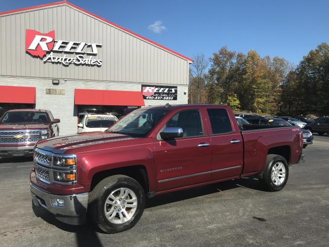 2014 Red /Black Chevrolet Silverado 1500 1LZ Double Cab 4WD (1GCVKSEC6EZ) with an 5.3L V8 OHV 16V engine, 6-Speed Automatic transmission, located at 11115 Chardon Rd. , Chardon, OH, 44024, (440) 214-9705, 41.580246, -81.241943 - Photo #0