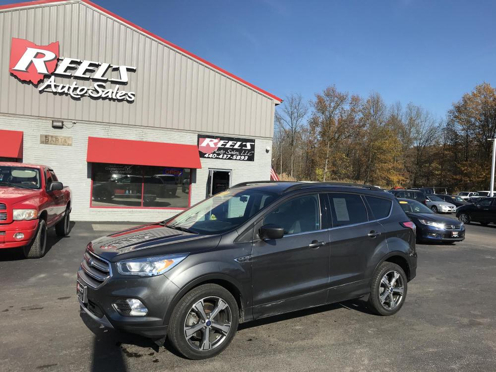 2017 Gray /Gray Ford Escape SE 4WD (1FMCU9GD2HU) with an 1.5L L4 DOHC 16V engine, 6A transmission, located at 547 E. Main St., Orwell, OH, 44076, (440) 437-5893, 41.535435, -80.847855 - Photo #0