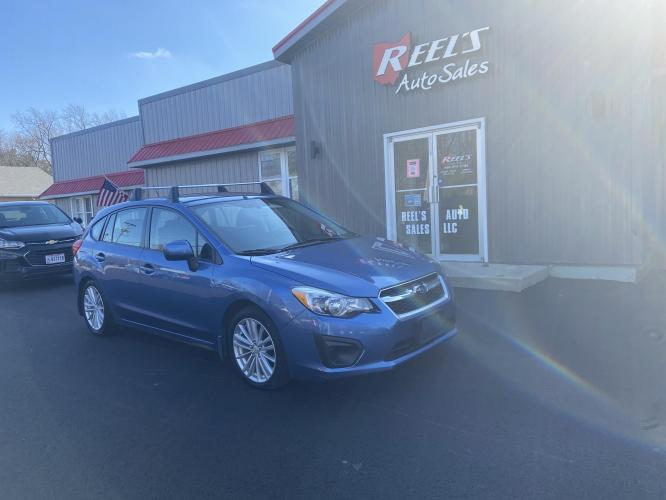 2014 Blue /Black Subaru Impreza Premium Plus 5-Door+S/R (JF1GPAD60E8) with an 2.0L H4 DOHC 16V engine, Continuously Variable Transmission transmission, located at 11115 Chardon Rd. , Chardon, OH, 44024, (440) 214-9705, 41.580246, -81.241943 - Photo #0