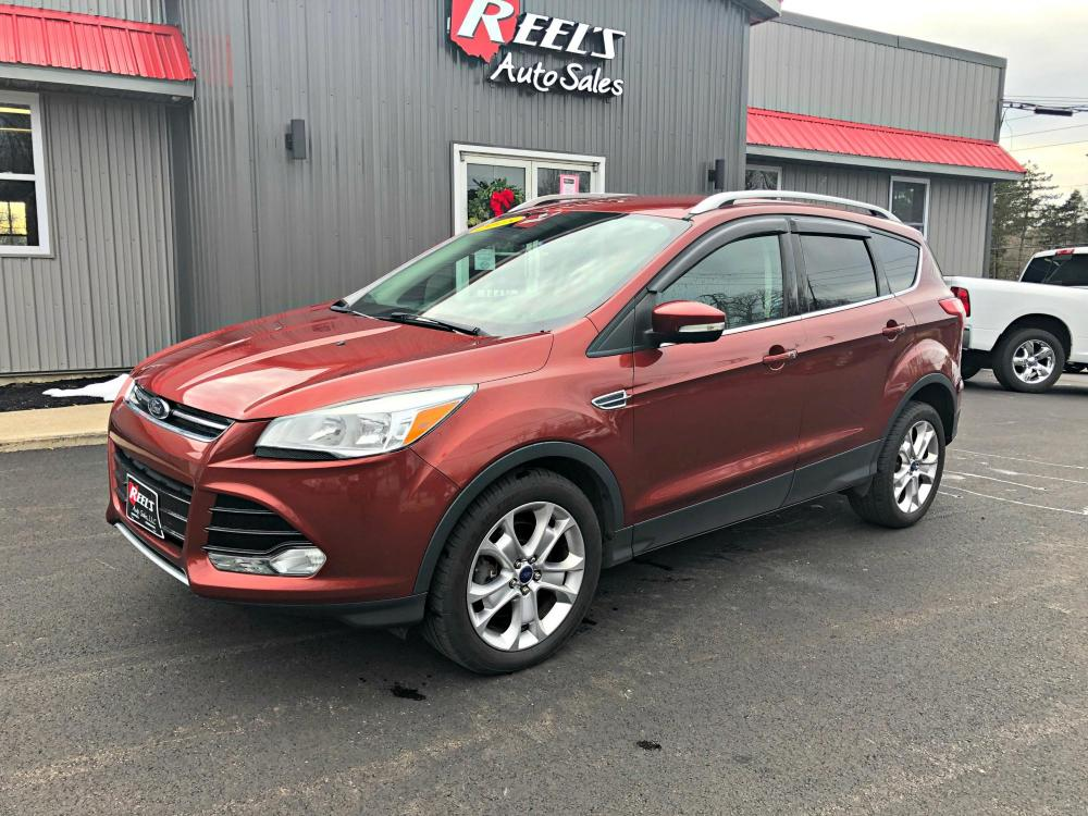 2015 Red /Black Ford Escape Titanium 4WD (1FMCU9JX5FU) with an 1.6L L4 DOHC 16V engine, Automatic transmission, located at 11115 Chardon Rd. , Chardon, OH, 44024, (440) 214-9705, 41.580246, -81.241943 - Photo #0