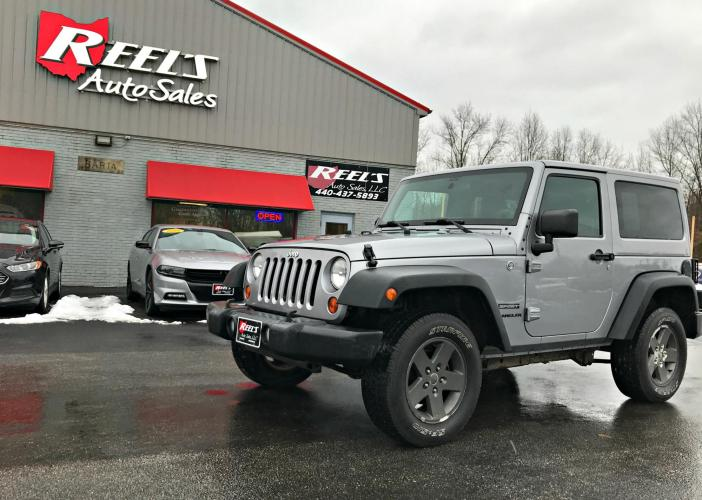 2013 Gray /Black Jeep Wrangler Sport 4WD (1C4AJWAG4DL) with an 3.6L V6 DOHC 24V FFV engine, Automatic transmission, located at 547 E. Main St., Orwell, OH, 44076, (440) 437-5893, 41.535435, -80.847855 - Photo #0